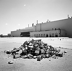 A pile of bricks and cinder blocks sits in a parking lot outside of a closed Chrysler assembly plant in Newark, Delaware. The plant once served as a major employer in northern Delaware and has since been demolished.