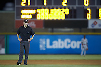 Umpire Kenny Jackson handles the calls at second base during the game between the Johnson City Cardinals and the Burlington Royals at Burlington Athletic Stadium on September 3, 2019 in Burlington, North Carolina. The Cardinals defeated the Royals 7-2 to even Appalachian League Championship series at one game a piece. (Brian Westerholt/Four Seam Images)