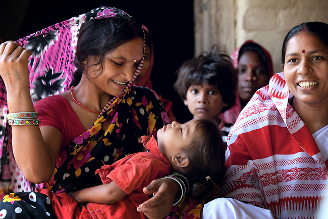 Kanti Devi with daughter Sushma at a treatment of oral rehydration salts (ORS) and zinc tablets for her diarrhea at an Anganwadi health centre in Pakauli village. The village located in Vaishali district outside Patna in Bihar, India has been rolling out the ORS and Zinc program as part of the IKEA Social Initiative to combat child mortality rates caused by diarrhea. It is proving to be very successful with education and support provided by local nursing staff, health activists  and program officers from UNICEF. The treatment is a 14 day course administering diluted oral rehydration salts and a zinc tablet which is more effective than salts alone in combating the effects of severe diarrhea. Picture by Graham Crouch/UNICEF