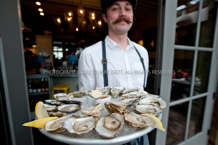 5/13/2011--Seattle, WA, USA..Walrus & The Carpenter, a  seafood restaurant in Seattle's Ballard neighborhood. The Walrus serves locally harvested oysters, clams and mussels, house-smoked fish, frites, and specialty meats...Here: Oyster platter with Samish, Olympia, Hama Hama, Treasure and Effingham oysters...©2011 Stuart Isett. All rights reserved.