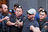 Moscow, Russia, 27/05/2012..A bearded Russian nationalist punches an arrested gay rights demonstrator at an attempted gay pride parade in central Moscow. Several dozen people were arrested during clashes as Russian nationalists attacked gay rights activists during their seventh attempt to hold a gay pride parade in the Russian capital.