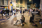 © Joel Goodman - 07973 332324 . Manchester , UK . 05/04/2015 . A man pushes himself up off the pavement on Withy Grove in Manchester City Centre . Revellers on a Saturday night out during the Easter Bank Holiday weekend . Photo credit : Joel Goodman