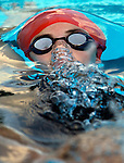 Mary Kate McNulty of the Razorback Aquatic Club competes in the girls 100 meter backstroke finals during the State Long Course Swimming Championships at the Springdale Aquatic Center.