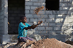 A year after Hurricane Matthew destroyed much of the village of Citerne Remy in Haiti's poverty-wracked northwest, 10-year old Clervency Mertilus plays in a pile of sand used in the construction of a new house being built by Church World Service, a member of the ACT Alliance.<br /> <br /> Parental consent obtained.