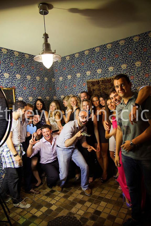 RUSSIA, Moscow. Group of friends posing for a picture at Delicatessen Restaurant.