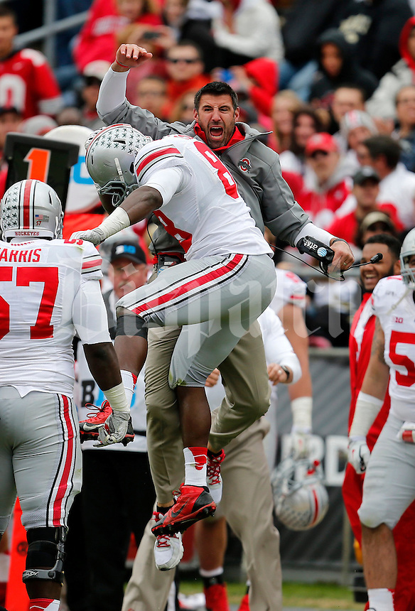 Ohio State Buckeyes defensive lineman Steve Miller (88) celebrates with coach Mike Vrabel during the second half of the NCAA football game at Ross-Ade Stadium in West Lafayette, IN on Saturday, November 2, 2013. (Columbus Dispatch photo by Jonathan Quilter)
