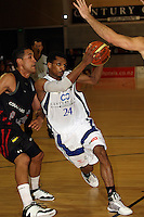 Saints guard Mike Efevberha tries to get past Cougars guard Paora Winitana during the NBL match between the Wellington Saints and Christchurch Cougars at Te Rauparaha Stadium, Porirua, Wellington, New Zealand on Saturday 4 April 2009. Photo: Dave Lintott / lintottphoto.co.nz