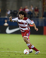 FC Dallas midfielder Juan Toja (8) dribbles the ball.  New England Revolution defeated FC Dallas 3-2 to capture the 2007 Lamar Hunt U.S. Open Cup at Pizza Hut Park in Frisco, TX on October 3, 2007.