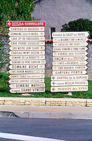 Road signs indicating the direction to various wine producers in Chateauneuf-du-Pape: La Sommellerie, du Vaudieu, Juliette Avril, Farguerol, Pierre Usseglio, Mestre Jean Claude, Mont Redon, de la Roquette, Pere Caboche, Riche, Boiron Maurice, Cigale, Cabrieres les Silex, Mathieu, Grand Veneur, Galet des Papes, Gonnet font de Michelle, Fines Roches, Terre Ferme, H Brunier Vieux Telegraphe, Lancon de la Solitude, Belevedere, H Boiron, Fortia, de la Gardine, Moulin Tacussel, Maison des Vins  Chateauneuf-du-Pape Châteauneuf, Vaucluse, Provence, France, Europe  Chateauneuf-du-Pape Châteauneuf, Vaucluse, Provence, France, Europe