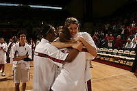 25 February 2006: Cissy Pierce, Candice Wiggins and Brooke Smith hug Krista Rappahahn during Stanford's 78-47 win over the Washington State Cougars at Maples Pavilion in Stanford, CA.