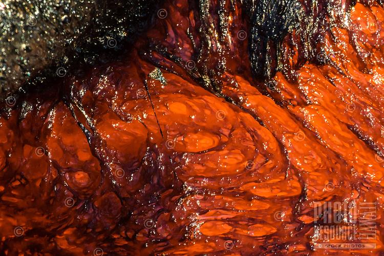 Strand of Pele's Hair: A close-up of molten, textured lava, with a dark strand of Pele's hair at center, Pulama Pali (of Holei Pali), Puna, Hawai'i Island, August 2017.