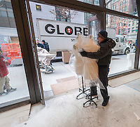 Movers from Globe Moving and Storage transfer mannequins slated for Parsons' famed School of Fashion into the new University Center building of the New School for Social Research in Greenwich Village in New York on Friday, December 27, 2013. The 16-story, multi-purpose building houses state-of-the-art classrooms,  a convertible auditorium and seven floors dormitories. The 375,000 square foot building opens in January 2014 and was designed by Skidmore, Owings & Merrill. The building will house students from the Eugene Lang College, the New School for Public Engagement, Mannes College as well as Parsons and the New School for Social Research.  (© Richard B. Levine)