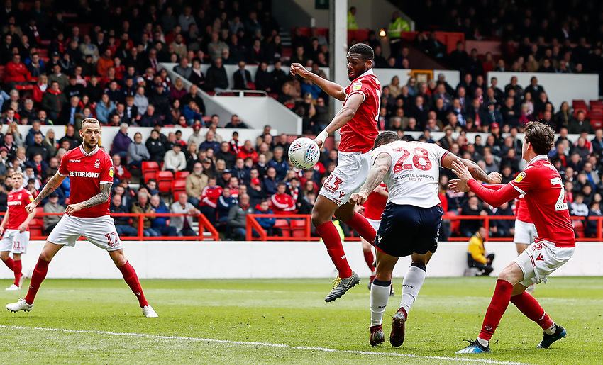 Bolton Wanderers' Josh Magennis heads at goal<br /> <br /> Photographer Andrew Kearns/CameraSport<br /> <br /> The EFL Sky Bet Championship - Nottingham Forest v Bolton Wanderers - Sunday 5th May 2019 - The City Ground - Nottingham<br /> <br /> World Copyright © 2019 CameraSport. All rights reserved. 43 Linden Ave. Countesthorpe. Leicester. England. LE8 5PG - Tel: +44 (0) 116 277 4147 - admin@camerasport.com - www.camerasport.com