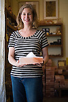 The Meadow, Portland, OR. Owner Jennifer Bitterman holds a Himalayan Salt plate topped with some New Zealand Marlborough Flakey salt at her store, The Meadow, a salt, chocolate, wine and flower shop in the North Mississippi neighborhood of Portland, OR