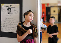 "Lorelei Shellenberger, 10, poses as Lena Horne as a group of students pass by as the 5th grade created a ""wax museum"" of historic black figures to celebrate Black History Month at Fallsington Elementary School Monday February 23, 2015 in Fallsington, Pennsylvania. (Photo by William Thomas Cain/Cain Images)"