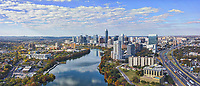 We love Austin Skyline in the fall and this aerial pano  show off the very urban Austin skyline that captures the downtown and all the high rise buildings hugging the shoreline of Lady Bird Lake with the city and IH35 in view. Again the water had this nice reflection of the clouds and high rise buildings in the water along with the colorful fall trees along the banks. This image capture this urban landscape of the Austin Skyline from the east side and shows some of the citys tallest buildings like the Austonian, the new Fairmont Hotel, with the top of the Frost just barely peeking above the crowd along the shoreline.  Also you can see the Frank Erwin Center and the UT stadium along IH35 to name just a few things seen in this cityscape. Until they finish the Independent the Austonian will remain the tallest in town at least for another year or more.  You can just barely see the top of the State Capitol trying to peek above all  the other high rise buildings in downtown but it is there at least for now. Austin is the fastest growing city in the US and the 11th most populous city and is the seat of the Texas State Capitol. At the last census this urban city had a population of just over 947,000 and growing. beecreekphoto.com
