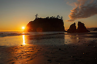The sun sets at Ruby Beach, just north of Kalaloch in Olympic National Park, Washington on July 20, 2016, behind Abbey Island, one of the many sea stacks. Sea stacks are rock formations that are remnants of former headlands that the winds and waters of the Pacific Ocean have since eroded into stacks of rock standing at the beach.