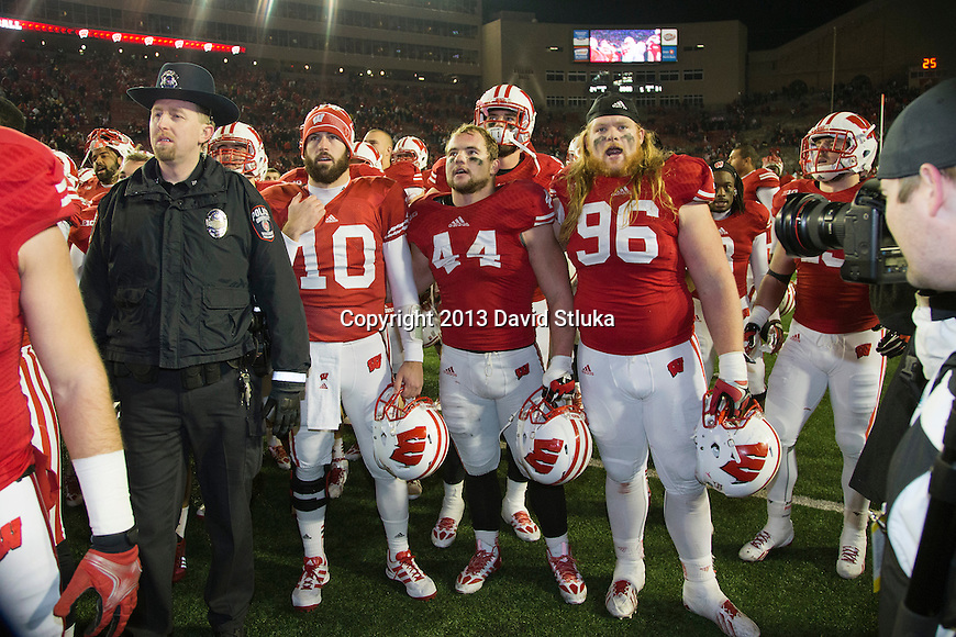 "Wisconsin Badgers seniors Curt Phillips (10), Chris Borland (44) and Beau Allen (96) sing ""On Wisconsin"" after an NCAA Big Ten Conference Football game against the Penn State Nittany Lions Saturday, November 30, 2013, in Madison, Wis. The Nittany Lions won 31-24. (Photo by David Stluka)"