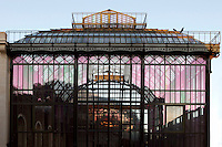 Plant History Glasshouse (formerly Australian Glasshouse), 1834, Charles Rohault de Fleury, Jardin des Plantes, Museum d'Histoire Naturelle, Paris, France. The glass and metal structure is seen in the late afternoon light reflecting the New Caledonia Glasshouse (formerly Mexican Hothouse).