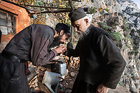 Mount Athos - The Holy Mountain.<br /> A monk kisses the hand of Father Arsenios for his 'blessing'.