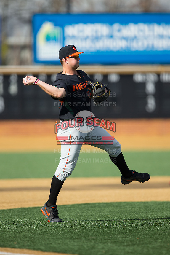 Miami Hurricanes third baseman David Thompson (8) makes a throw to first base against the Wake Forest Demon Deacons at Wake Forest Baseball Park on March 21, 2015 in Winston-Salem, North Carolina.  The Hurricanes defeated the Demon Deacons 12-7.  (Brian Westerholt/Four Seam Images)