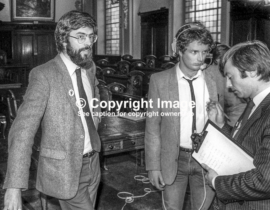 Sinn Fein president Gerry Adams, left, who was one of five party candidates, who won seats for the first time in the N Ireland Assembly in the October 1982 election. He is pictured waiting to be interviewed by BBC journalist Peter Gould. Know the guy in the middle? Please advise. 198210200154_GA+PG<br />