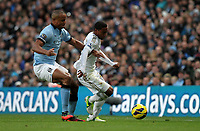 Barclays Premier League, Man City (blue) V Swansea City (white) Etihad Stadium, 27/10812<br /> Pictured: City defender Victor Kompany tangles with Jonathan De Guzman<br /> Picture by: Ben Wyeth / Athena Picture Agency