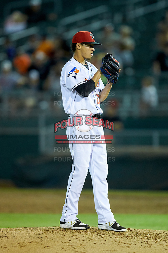 Lansing Lugnuts relief pitcher Emerson Jimenez (26) looks to his catcher for the sign against the South Bend Cubs at Cooley Law School Stadium on June 15, 2018 in Lansing, Michigan. The Lugnuts defeated the Cubs 6-4.  (Brian Westerholt/Four Seam Images)