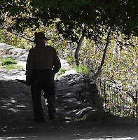 Old farmer walking along a shady path, Bubion, gorge of the Poqueira river, Alpujarra, Andalucia, Southern Spain. Photograph by Manuel Cohen.