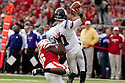 05 November 2011: Dan Persa #7 of the Northwestern Wildcats is tackled by Eric Martin #46 of the Nebraska Cornhuskers in the second quarter at Memorial Stadium in Lincoln, Nebraska.  Northwestern defeated Nebraska 28 to 25.