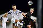GREENSBORO, NC - DECEMBER 02: Justin Brautigam #21 of Messiah College battles Henrik Roesholt #31 of North Park University for the ball during the Division III Men's Soccer Championship held at UNC Greensboro Soccer Stadium on December 2, 2017 in Greensboro, North Carolina. Messiah College defeated North Park University 2-1 to win the national title. (Photo by Grant Halverson/NCAA Photos via Getty Images)