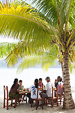 FRENCH POLYNESIA, Vahine Island. A family having lunch at the Vahine Private Island Resort.