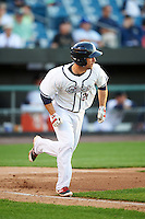 Syracuse Chiefs second baseman Scott Sizemore (25) runs to first base during a game against the Louisville Bats on June 6, 2016 at NBT Bank Stadium in Syracuse, New York.  Syracuse defeated Louisville 3-1.  (Mike Janes/Four Seam Images)