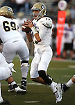 UC Davis quarterback Ben Scott looks upfield during the first half of an NCAA college football game against Nevada in Reno, Nev. on Thursday, Sept. 3, 2015. (AP/Cathleen Allison)