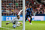 Atletico de Madrid's Antoine Griezmann scores goal and Club Brugge's Karlo Letica (L) and Stefano Denswil (R) during UEFA Champions League match between Atletico de Madrid and Club Brugge at Wanda Metropolitano Stadium in Madrid, Spain. October 03, 2018. (ALTERPHOTOS/A. Perez Meca)