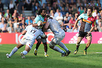 Marland Yarde of Harlequins is tackled by Ben Moon and David Ewers of Exeter Chiefs during the Aviva Premiership match between Harlequins and Exeter Chiefs at The Twickenham Stoop on Saturday 7th May 2016 (Photo: Rob Munro/Stewart Communications)