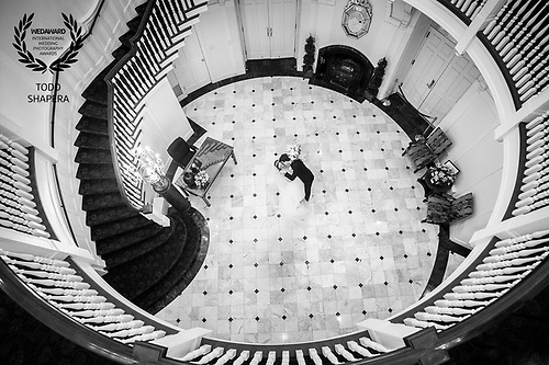 A wedding couple embraces in the elegant rotunda of Tappan Hill Mansion/