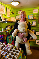Julie Ashby, owner of Pooh Corner, a shop and teashop dedicated to the A.A. Milne Winnie the Pooh stories. Ashdown Forest, Sussex, UK, May 20, 2017. Picturesque Ashdown Forest stretches across the countries of Surrey, Sussex and Kent, and is the largest open access space in the South East of England. It is famous as the geographical inspiration for the Winnie the Pooh stories and is popular with fans of the characters.
