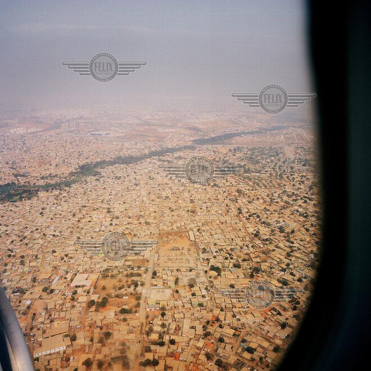An aerial view of Luanda through an aeroplane window..