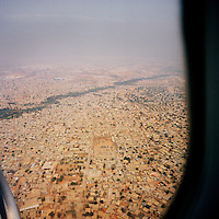An aerial view of Luanda through an aeroplane window..