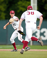 STANFORD, CA - March 29, 2011: Stephen Piscotty of Stanford baseball throws to first during Stanford's game against St. Mary's at Sunken Diamond. Stanford won 16-14.