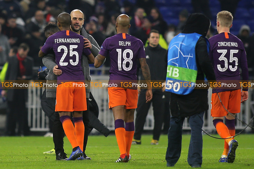 Manchester City Manager, Pep Guardiola shows his delight at the final whistle as he celebrates with Fernandinho during Lyon vs Manchester City, UEFA Champions League Football at Groupama Stadium on 27th November 2018