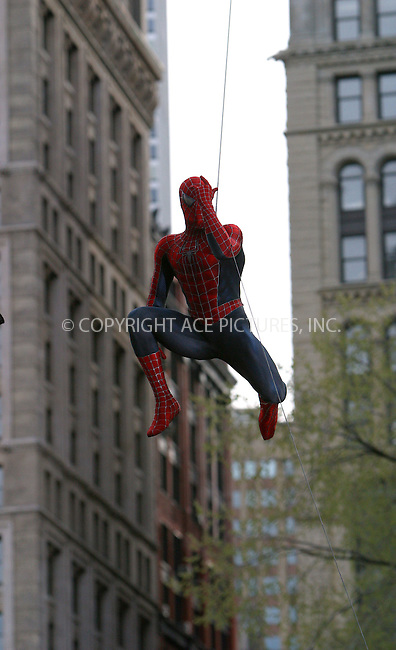 """Spider-Man 2"" film set in Downtown Manhattan near Brooklyn Bridge. Pictured: Tobey Maguire's stunt double performs flying stunt. New York, April 20, 2003. Please byline: Alecsey Boldeskul/NY Photo Press.   ..*PAY-PER-USE*      ....NY Photo Press:  ..phone (646) 267-6913;   ..e-mail: info@nyphotopress.com"