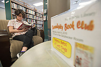 NWA Democrat-Gazette/J.T. WAMPLER Melani Bernal ((CQ)), 17 of Pea Ridge reads Wednesday March 23, 2016 at the Rogers Public Library. The library is hosting a Hunger Games movie marathon, showing the first two movies Wednesday and finishing with the last two today (Thursday) starting at 3:00 P.M. in the Community Room. For more information about activities at the library see the internet at rogerspubliclibrary.org/