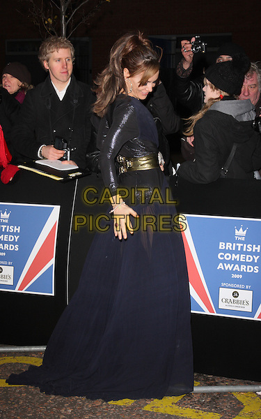 TARA PALMER TOMKINSON.British Comedy Awards 2009 held at the ITV Studios, South Bank, London,.December 12th 2009..full length navy blue sheer see through dress long maxi gold belt waistband hand ring back rear behind .CAP/ROS.©Steve Ross/Capital Pictures.