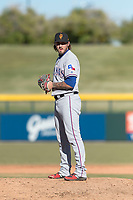 Surprise Saguaros relief pitcher Joe Barlow (19), of the Texas Rangers organization, gets ready to deliver a pitch during an Arizona Fall League game against the Mesa Solar Sox at Sloan Park on November 15, 2018 in Mesa, Arizona. Mesa defeated Surprise 11-10. (Zachary Lucy/Four Seam Images)