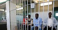 Prima udienza del processo ai presunti pirati somali accusati dell'attacco alla nave portacontainer italiana Montecristo presso la III Corte d'Assise a Roma, 23 marzo 2012. La nave, assaltata il 10 ottobre 2011 al largo della Somalia, venne liberata il 15 ottobre dai Royal Marines britannici con l'ausilio di una nave militare statunitense..Somali allegedly pirates sit inside a cage during the opening audience for the assault to the Montecristo container ship, in Rome, 23 march 2012. The ship was attacked on 10 october 2011 and freed by US navy and British Royal Marines on 15 october..UPDATE IMAGES PRESS/Riccardo De Luca