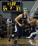 Utah State guard Sam Merrill (5) brings the ball up the court against Nevada in the second half of an NCAA college basketball game in Reno, Nev., Wednesday, Jan. 2, 2019. (AP Photo/Tom R. Smedes)