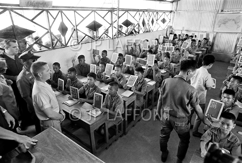 Bien Hoa, Vietnam. April 1970. Businessman Ross Perot, founder of Electronic Data Systems, Inc., visits a classroom at a Prisoners of War camp in Bien Hoa, South Vietnam. He was appointed by United States Secretary of the Navy John Warner to report on the conditions of Americans in Vietnamese and Laotian POW camps for four years, until the prisoners were released in 1972 at the end of the Vietnam War.