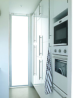 The entrance to the kitchen is via a glass door ensuring maximum light